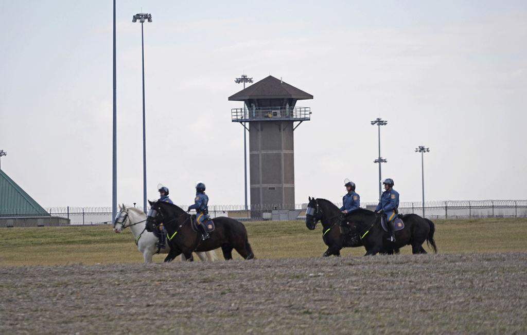 Mounted police patrol travel along Smyrna Landing Road alongside James T. Vaugh Corrections center, Thursday, Feb. 2, 2017 in Smyrna, D...