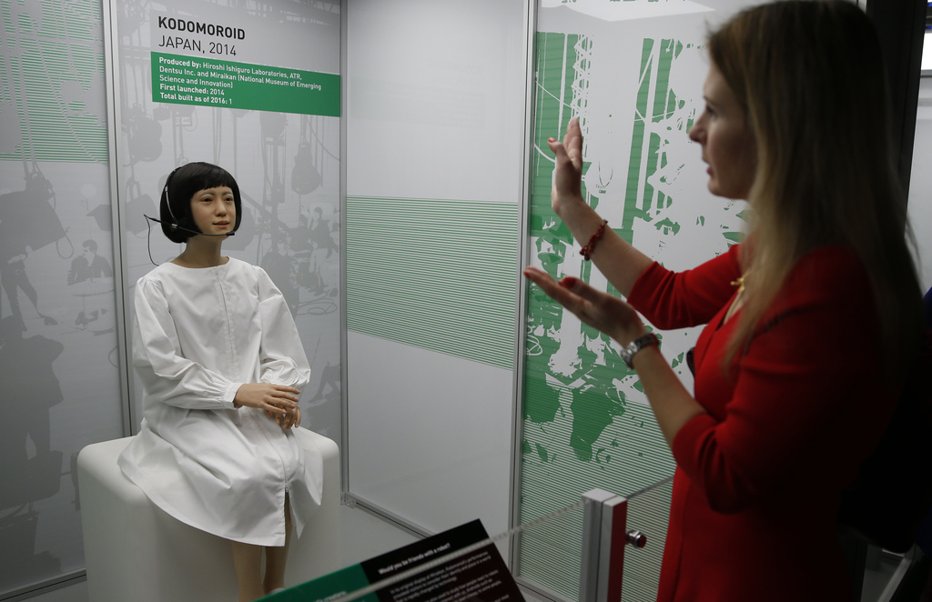 A member of the media tries to attract the attention of Kodomoroid a life like Japanese robot, which is a designed robotic news reader ...