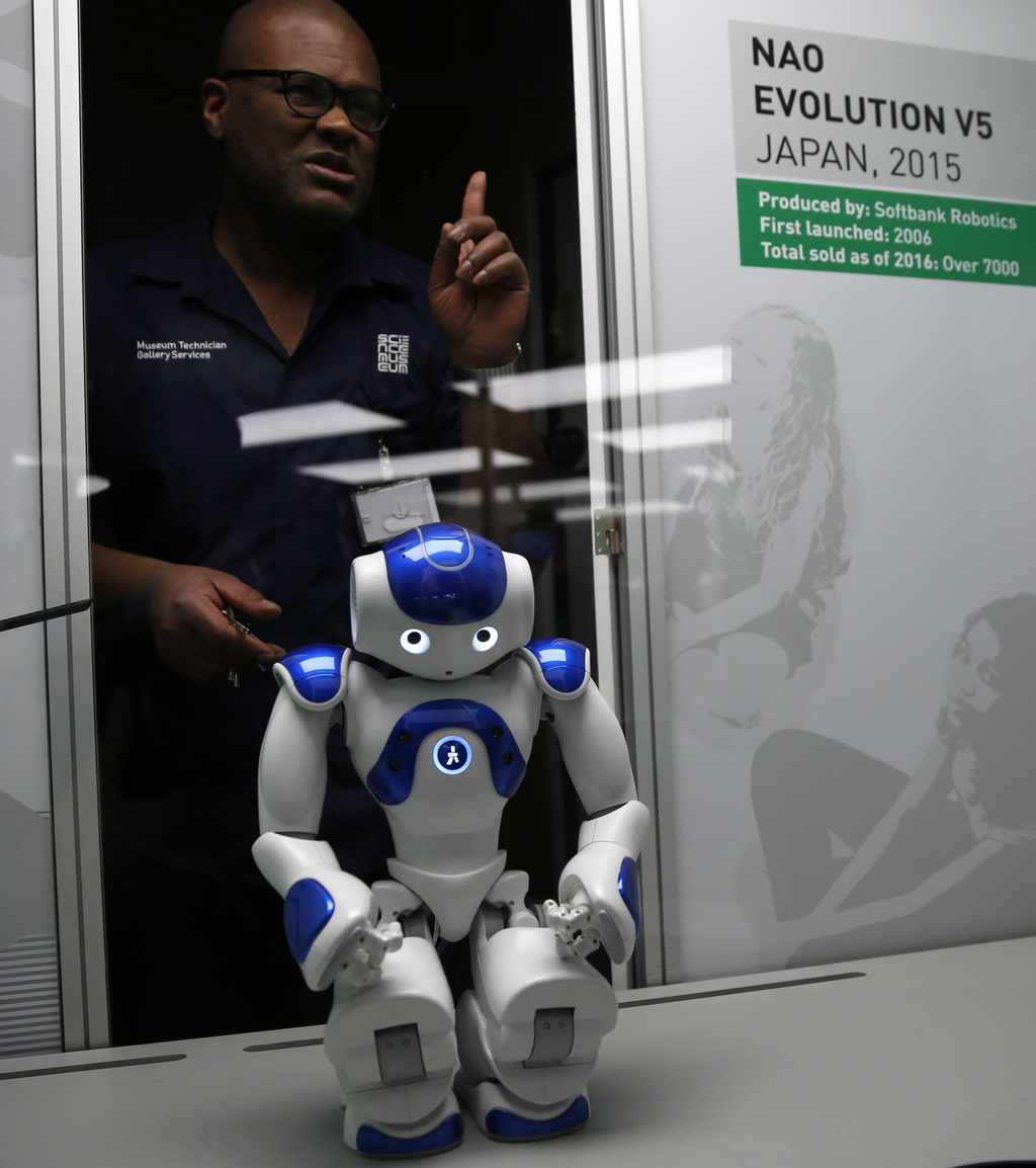 A technician adjusts Nao Evolution robot from Japan, during a press preview for the Robots exhibition held at the Science Museum in Lon...