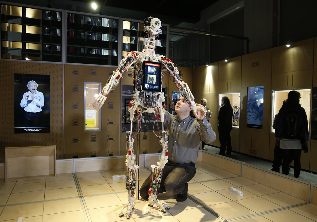 A technician adjusts Rob's Open Source Android (ROSAL) which was built in France from 2010-2016, during a press preview for the Robots ...
