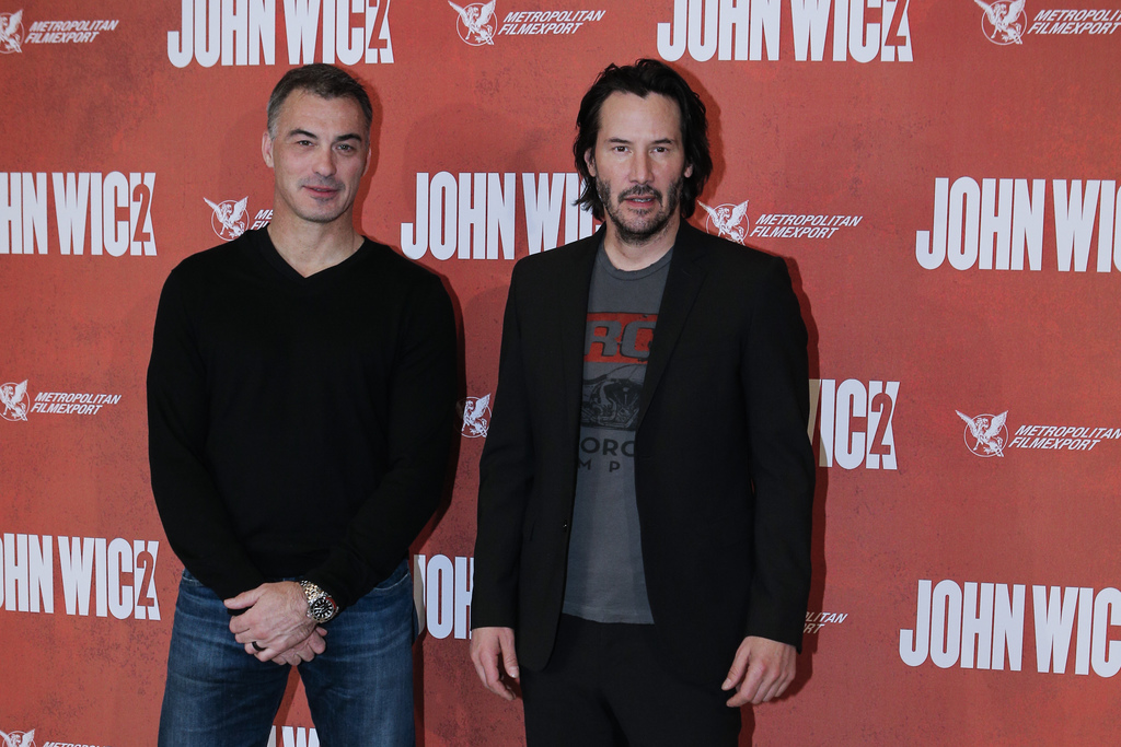 Director Chad Stahelski, left, and actor Keanu Reeves pose for the media as they arrive for the French premiere for 'John Wick 2' in Pa...