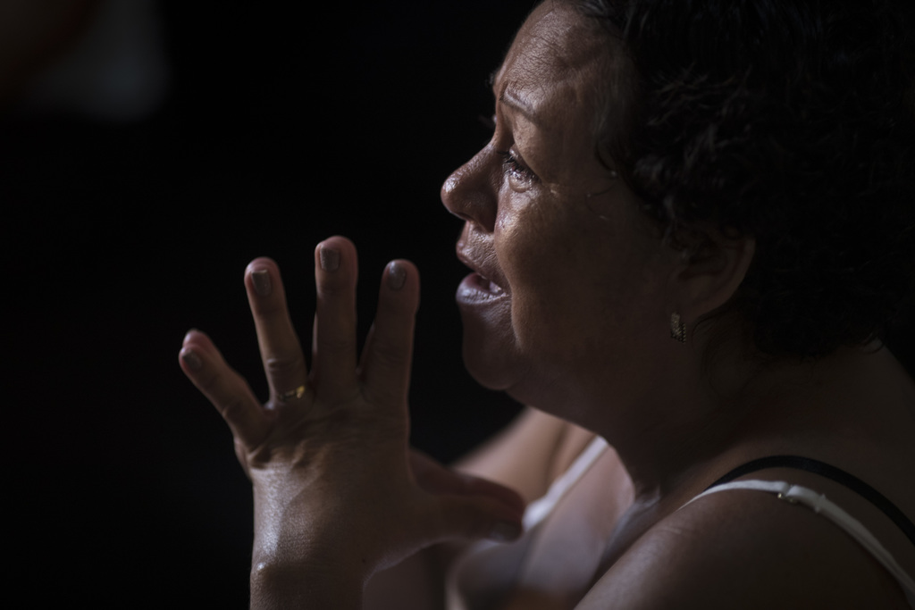 In this Jan. 23, 2017 photo, Maria Jose de Souza talks about her husband who died in a massacre inside Alcacuz prison in Natal, Brazil....