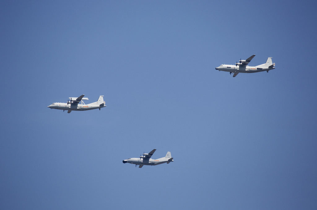 FILE - In this Sept. 3, 2015 file photo, a KJ-200 airborne early warning and control plane, left, a Y-8J radar plane, center, and a Y-9