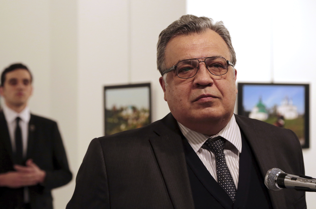 FILE - In this Monday, Dec. 19, 2016 file photo Andrei Karlov, the Russian ambassador to Turkey, speaks at an art gallery before being ...
