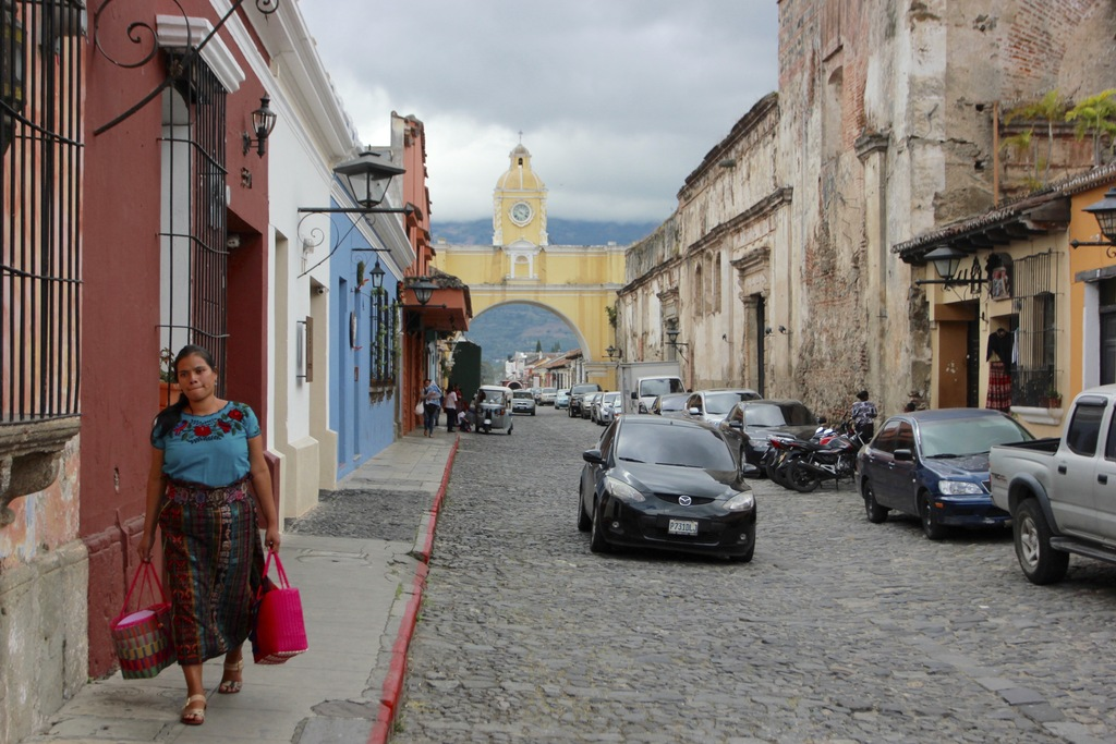 In this photograph taken Dec. 14, 2016, an indigenous woman walks on the street where the Santa Catalina arch is located in Antigua Gua...