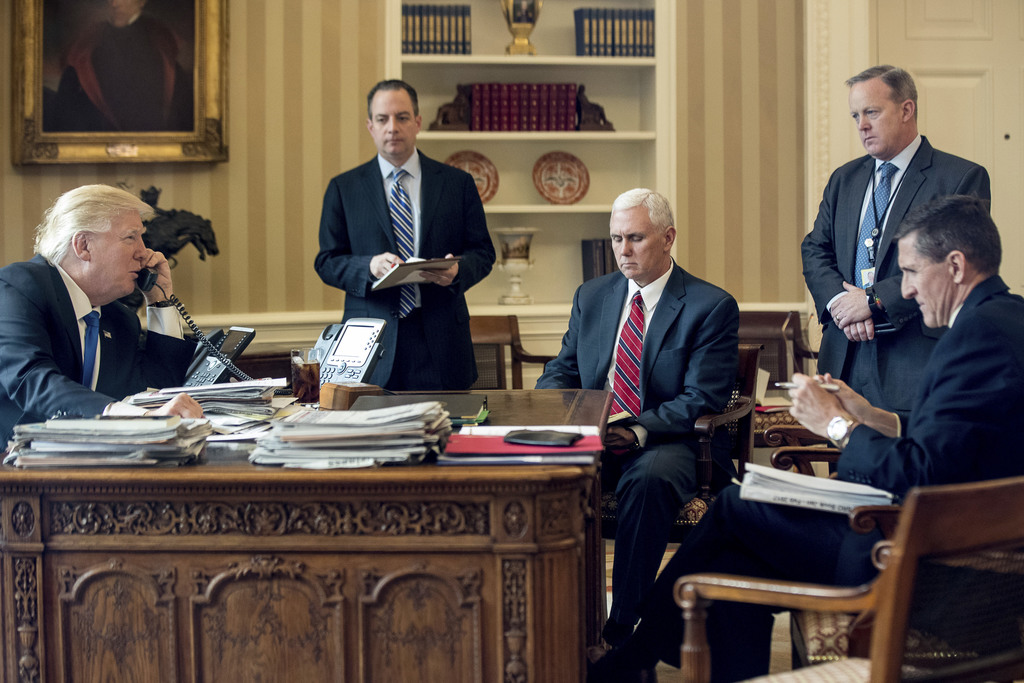 FILE - In this Jan. 28, 2017, file photo, President Donald Trump accompanied by, from second from left, Chief of Staff Reince Priebus, ...