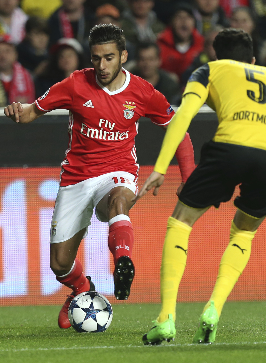 Benfica's Eduardo Salvio fights for the ball against Dortmund's Marc Bartra during the Champions League round of 16, first leg, soccer ...