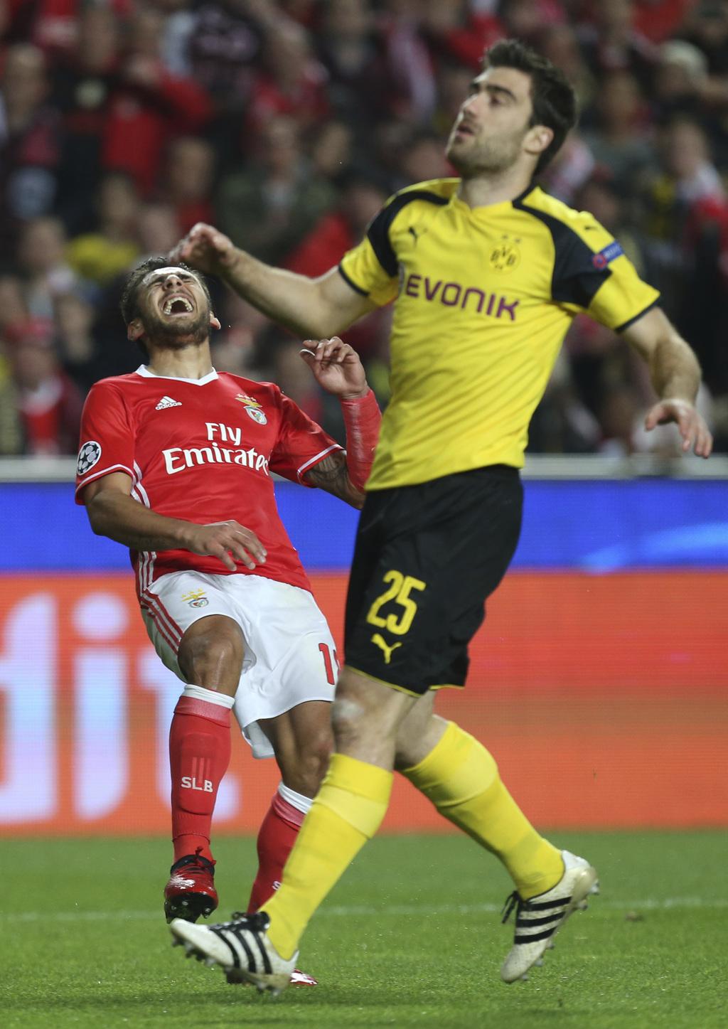 Benfica's Eduardo Salvio reacts next to Dortmund's Sokratis Papastathopoulos during the Champions League round of 16, first leg, soccer...