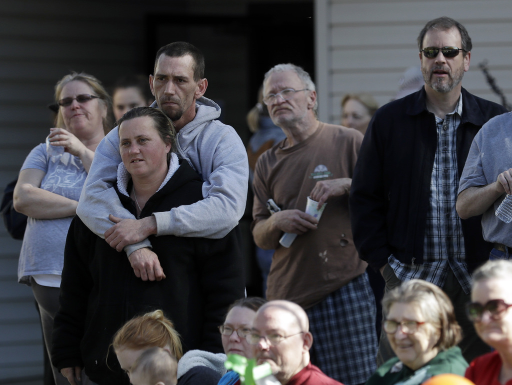 Evacuees listen to an announcement lifting the evacuation of the Oroville Dam communities Tuesday, Feb. 14, 2017, in Chico, Calif. Auth...