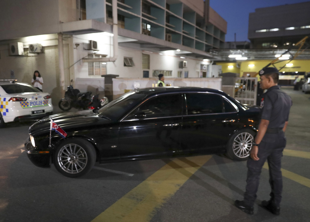 North Korean Ambassador to Malaysia Kang Chol's car leaves the forensic department at a hospital in Kuala Lumpur, Malaysia, Wednesday, ...