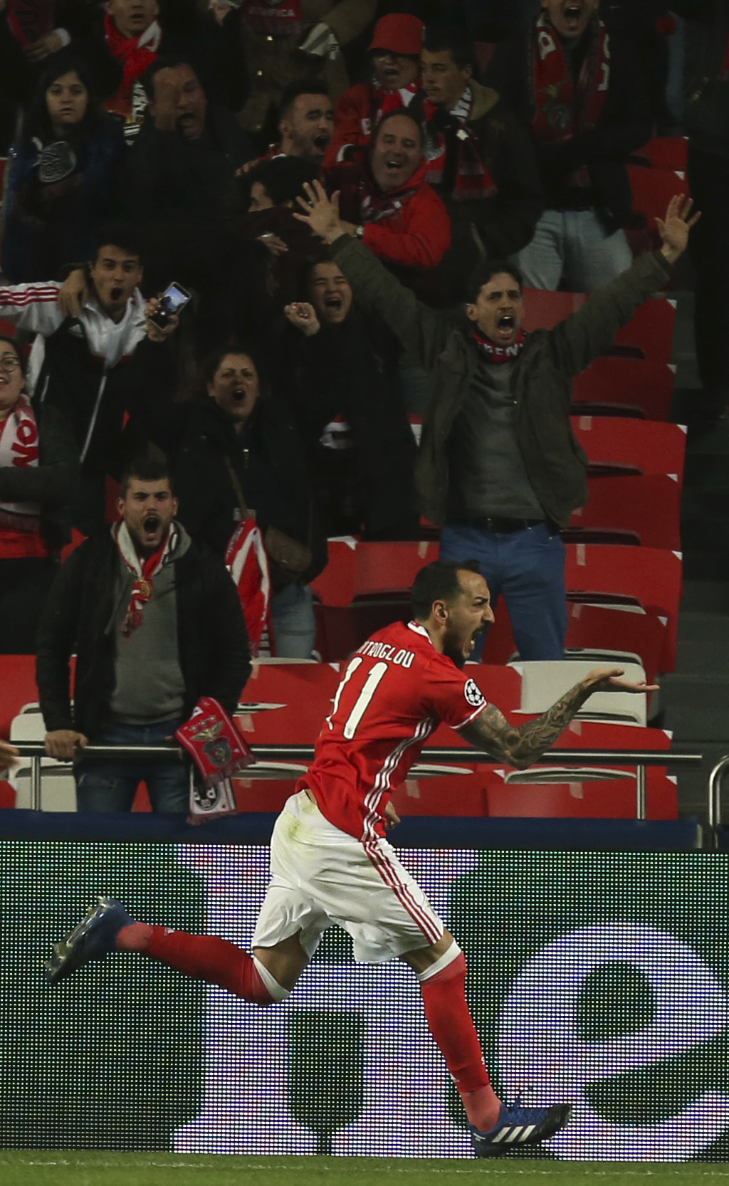 Benfica's Kostas Mitroglou celebrates scoring the opening goal during the Champions League round of 16, first leg, soccer match between...