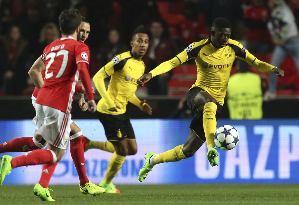 Dortmund's Ousmane Dembele fights for the ball during the Champions League round of 16, first leg, soccer match between Benfica and Bor...