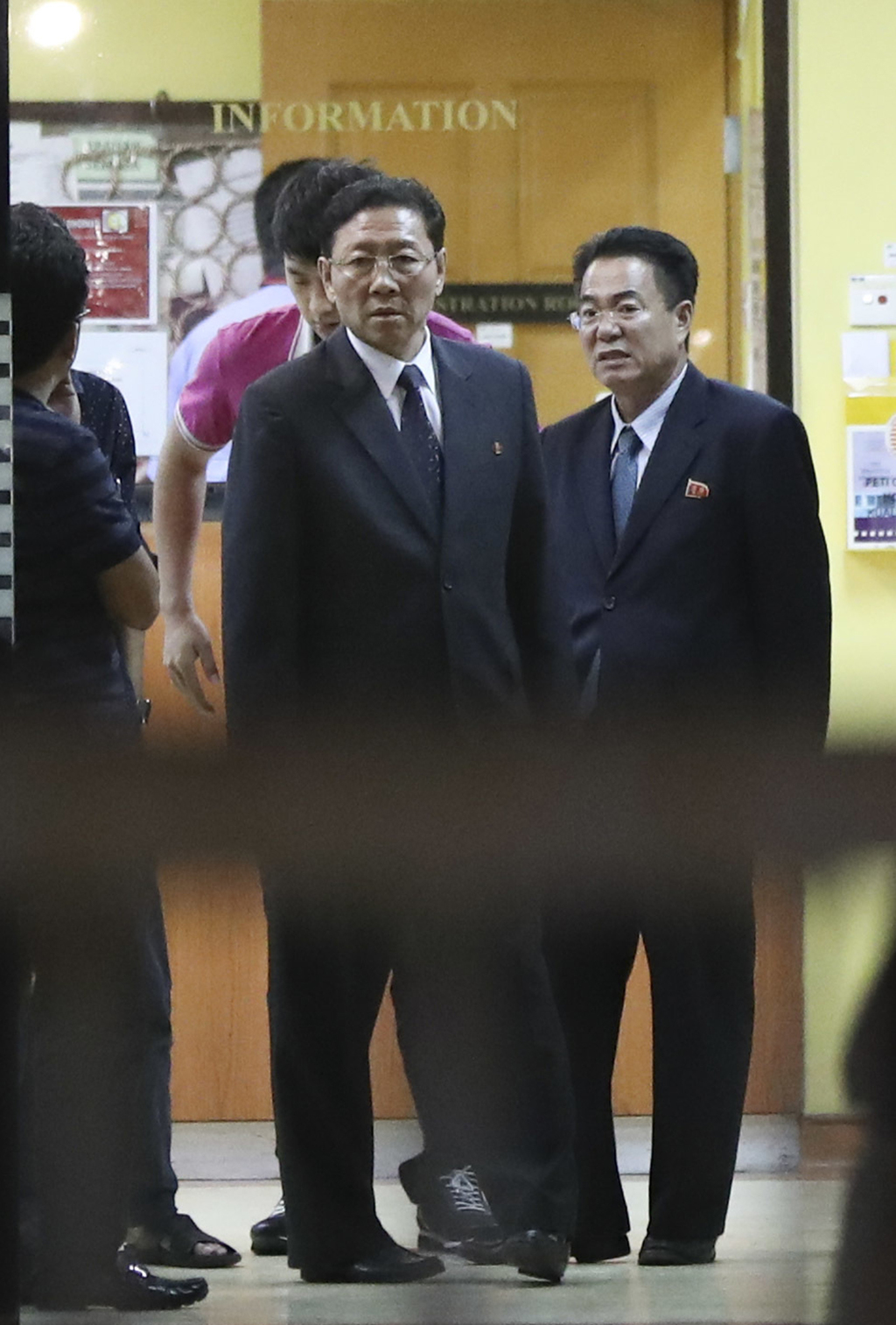 North Korean Ambassador to Malaysia Kang Chol, center, stands at the entrance as he prepares to leave the forensic department at a hosp...