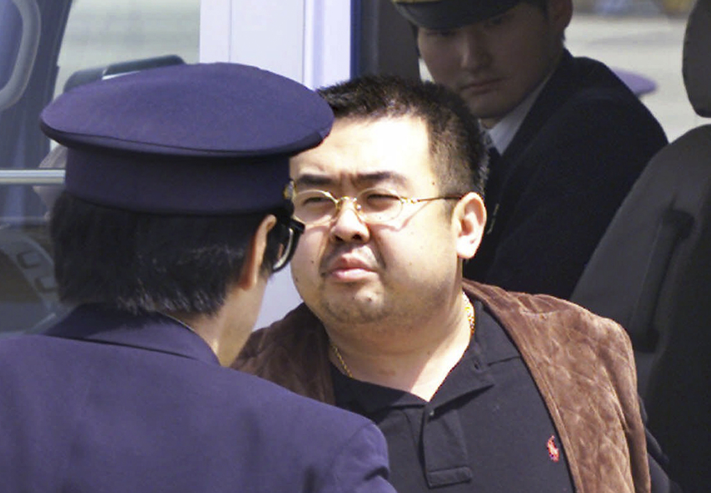 FILE - This May 4, 2001, file photo shows Kim Jong Nam, exiled half brother of North Korea's leader Kim Jong Un, escorted by Japanese p...