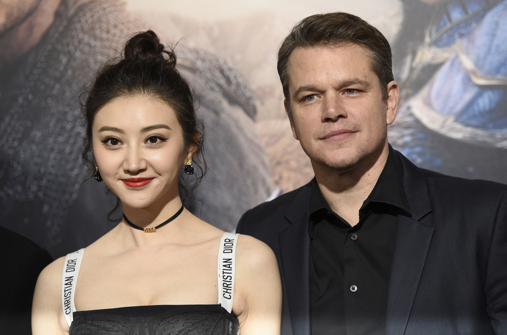 """Jing Tian, left, and Matt Damon, cast members in """"The Great Wall,"""" pose together at the premiere of the film at the TCL Chinese Theatre..."""
