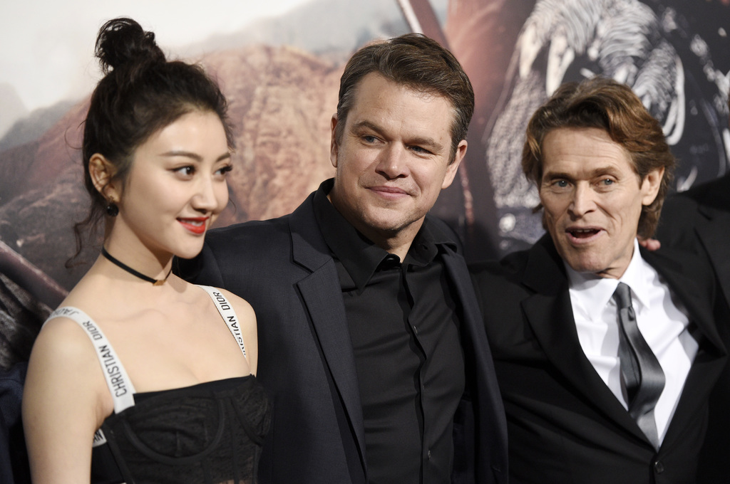 """Jing Tian, from left, Matt Damon, and Willem Dafoe, cast members in """"The Great Wall,"""" pose together at the premiere of the film at the ..."""