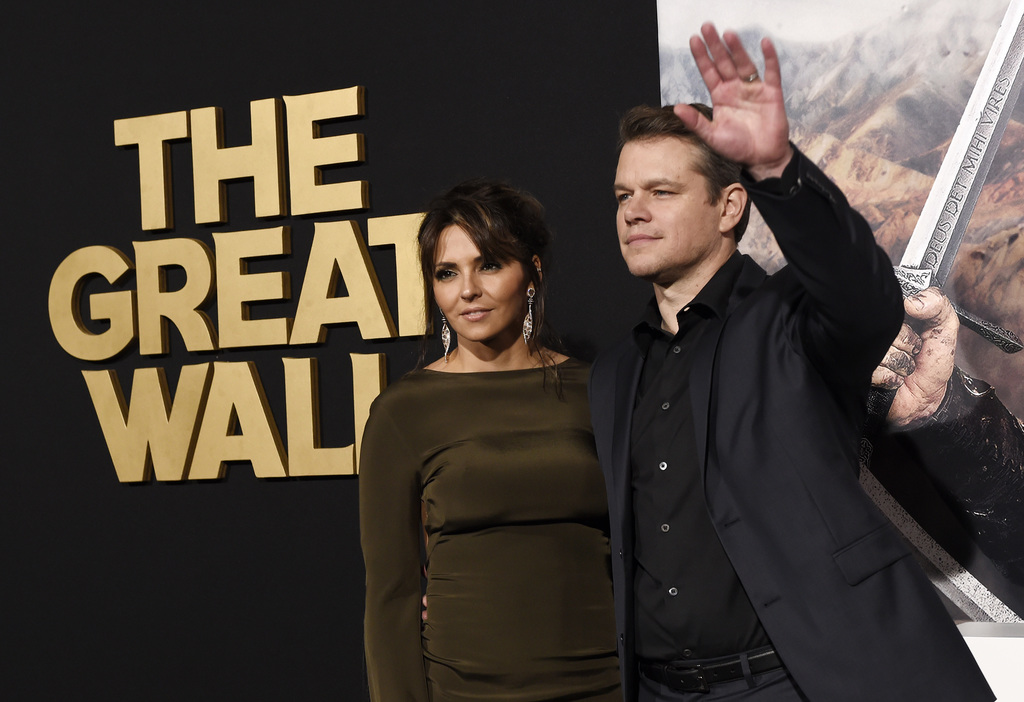 """Matt Damon, a cast member in """"The Great Wall,"""" poses with his wife Luciana Barroso at the premiere of the film at the TCL Chinese Theat..."""