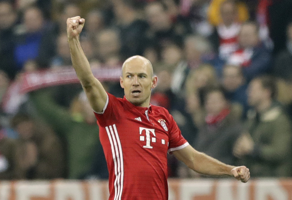 Bayern's Arjen Robben celebrates after scoring the opening goal during the Champions League round of 16 first leg soccer match between ...