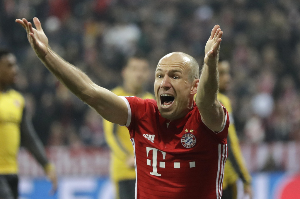 Bayern's Arjen Robben gestures as he questions a referee call during the Champions League round of 16 first leg soccer match between FC...