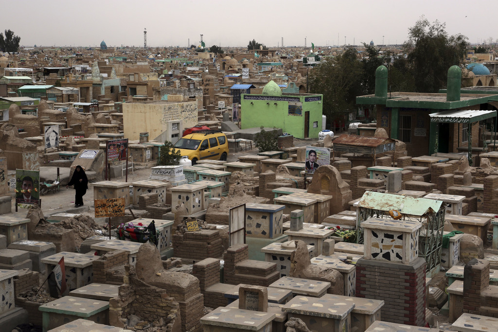 """This Wednesday, Feb. 15, 2017 photo shows general view of the Wadi al-Salam, or """"Valley of Peace"""" cemetery which contains the graves of..."""