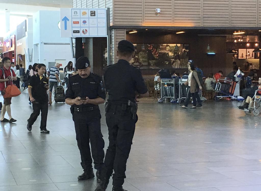 Police officers man at Kuala Lumpur International Airport where North Korean Kim Jong Nam was reportedly assassinated in Kuala Lumpur, ...
