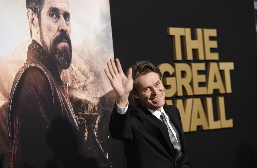 """Willem Dafoe, a cast member in """"The Great Wall,"""" waves to photographers at the premiere of the film at the TCL Chinese Theatre on Wedne..."""