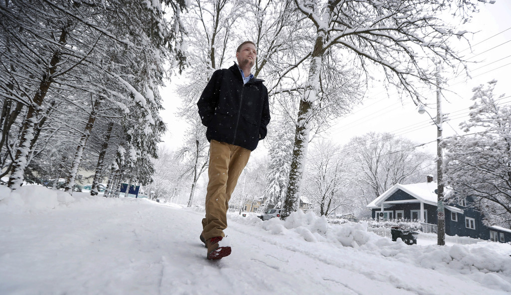 In this Jan. 25, 2017, photo, face transplant recipient Andy Sandness walks to the Saint Marys Hospital campus at Mayo Clinic in Roches...