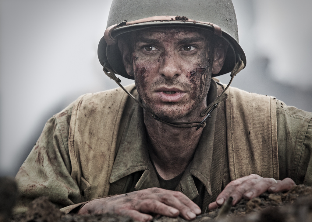 """FILE - This image released by Summit shows Andrew Garfield in a scene from """"Hacksaw Ridge."""" The film has been nominated for an Oscar in..."""