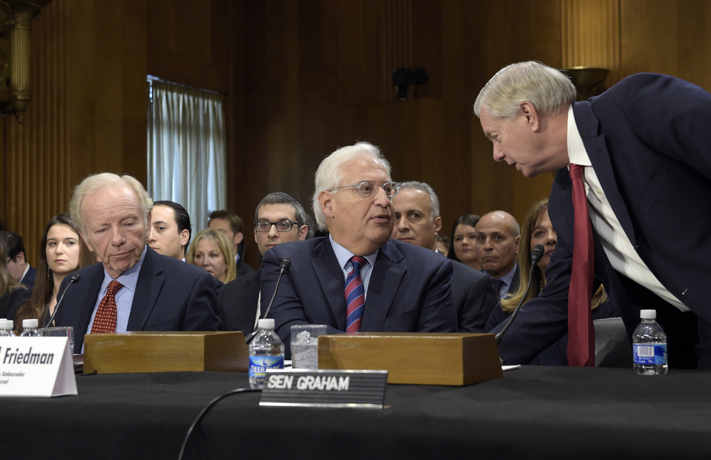 FILE - In this Wednesday, Feb. 15, 2017 file photo, Sen. Lindsey Graham, R-S.C., right, talks with David Friedman, center, nominated to...