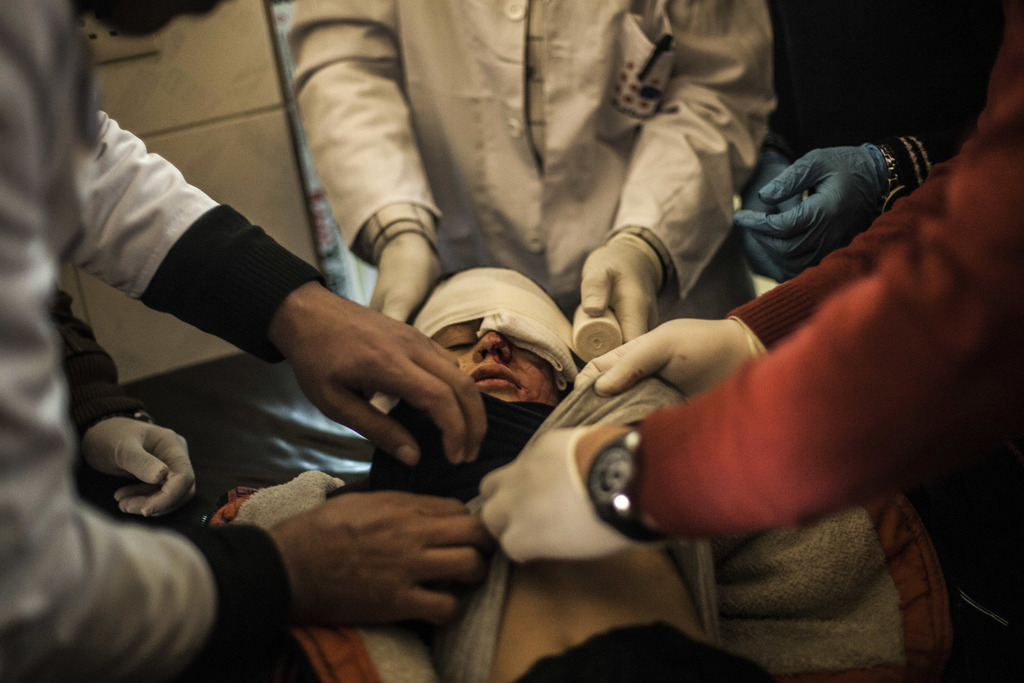 FILE -- In this Dec. 7, 2016 file photo, Yousuf Odey, 10, who was wounded in the eye by Islamic State militants, is treated by doctors ...