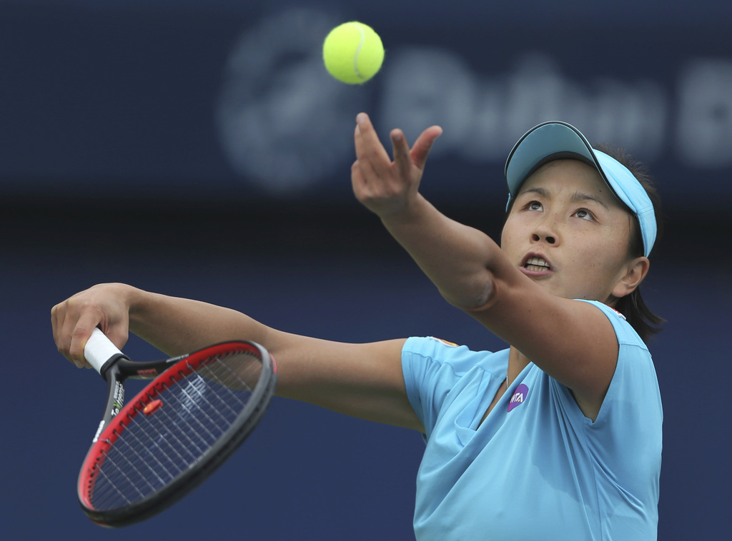 Shuai Peng of China serves the ball to Lesia Tsurenko of Ukraine during the Dubai Tennis Championships in Dubai, United Arab Emirates, ...