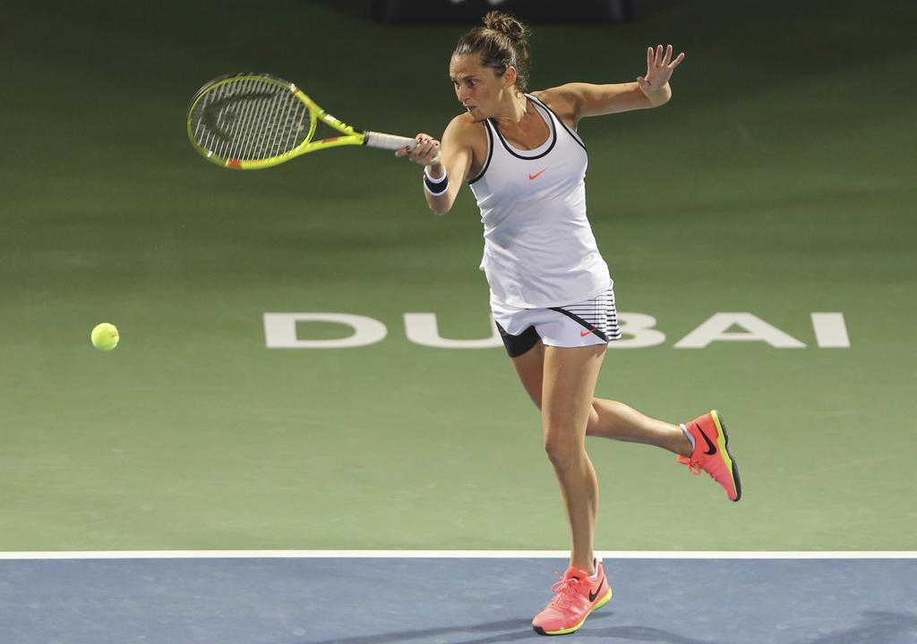 Roberta Vinci of Italy returns the ball to Kristyna Pliskova of Czech Republic during the Dubai Tennis Championships in Dubai, United A...