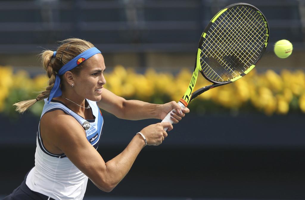 Monica Puig of Portugal returns the ball to Yaroslavl Shvedova of Kazakistan during the Dubai Tennis Championships in Dubai, United Ara...