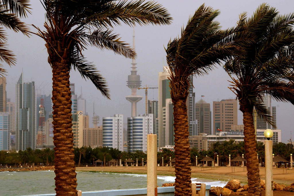 FILE- In this April 16, 2009 file photo, the Kuwait city skyline is seen through the haze of a sand storm in Shuwaikh, Kuwait City. In ...
