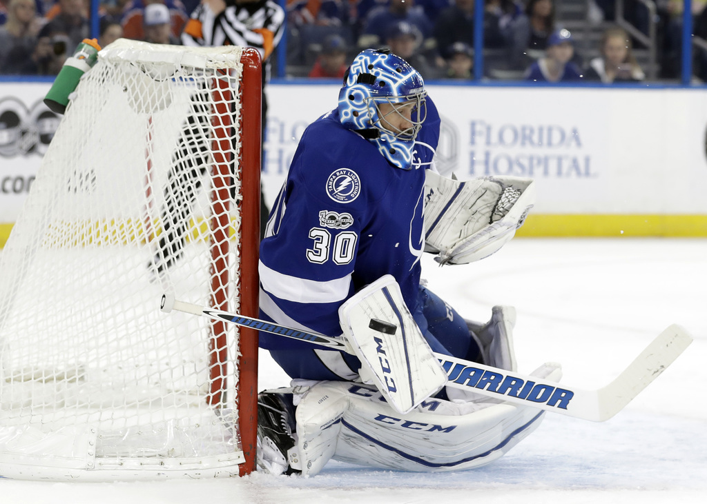 Tampa Bay Lightning goalie Ben Bishop (30) makes a blocker save on a shot by the Edmonton Oilers during the first period of an NHL hock...