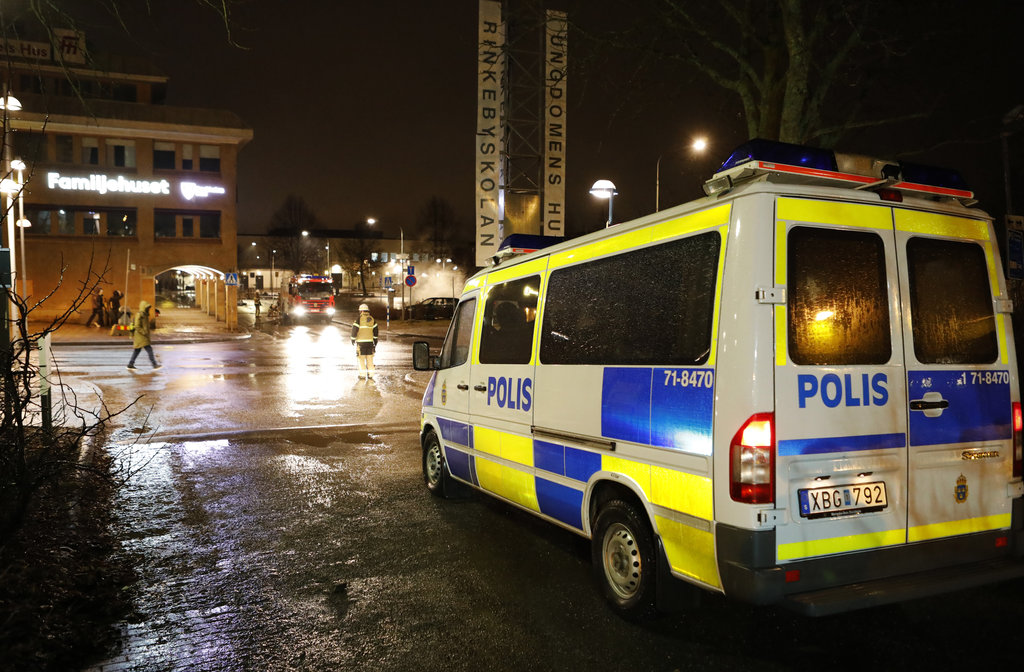 A police car in the suburb Rinkeby outside Stockholm, Monday Feb. 20, 2017.  Swedish police on Tuesday were investigating a riot that b...