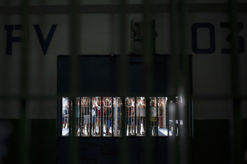 In this Feb. 2, 2017 photo, inmates stand behind bars in Pavilion 03 at the Anisio Jobim penitentiary complex, known by its Portuguese ...