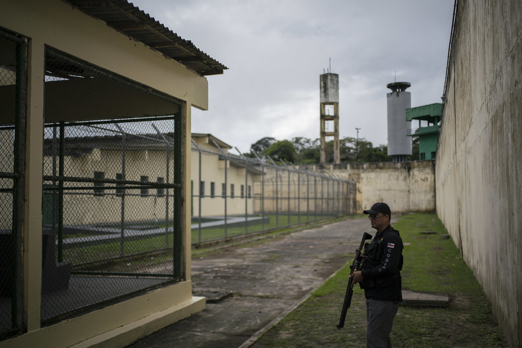 In this Feb. 2, 2017 photo, a guard stands inside the Anisio Jobim penitentiary complex, known by its Portuguese acronym of Compaj, in ...