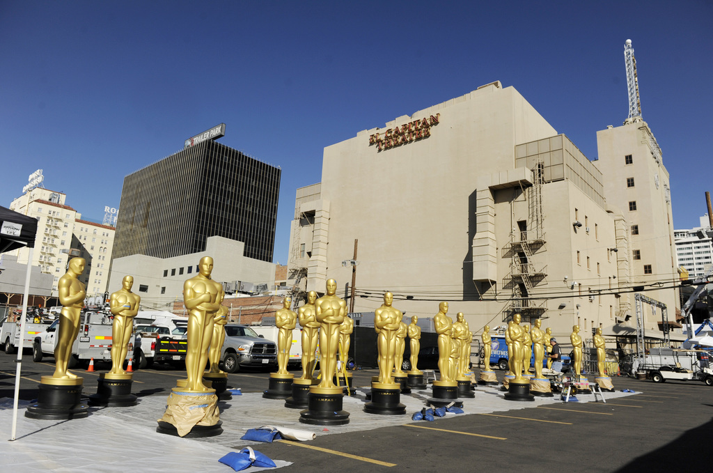 Oscar statues for Sunday's 89th Academy Awards red carpet stand in a parking lot near Hollywood Boulevard on Wednesday, Feb. 22, 2017, ...