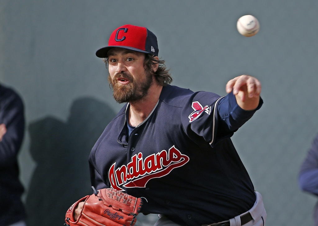 FILE - In this Tuesday, Feb. 14, 2017, file photo, Cleveland Indians pitcher Andrew Miller throws a pitch at the Indians baseball sprin...