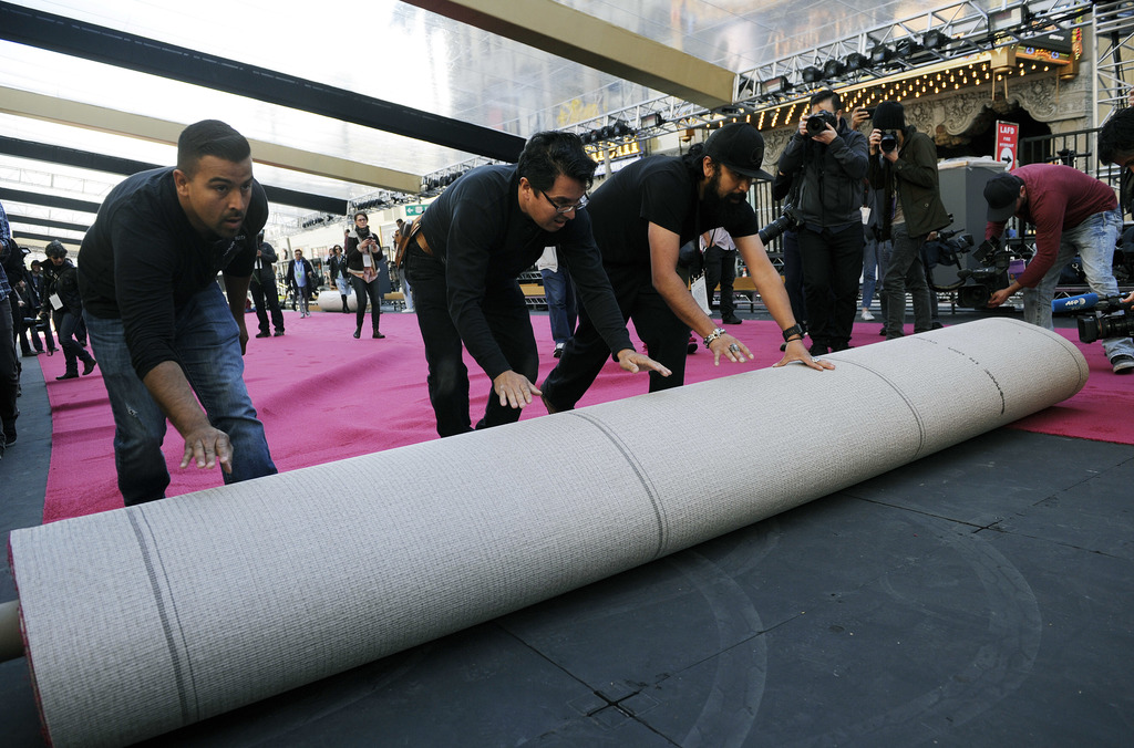 Crew workers roll out the red carpet for the 89th Academy Awards in front of the Dolby Theatre on Wednesday, Feb. 22, 2017, in Los Ange...