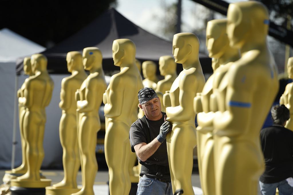 Scenic artist Rick Roberts of Local 800 primps Oscar statues near the Dolby Theatre on Wednesday, Feb. 22, 2017, in Los Angeles. The 89...