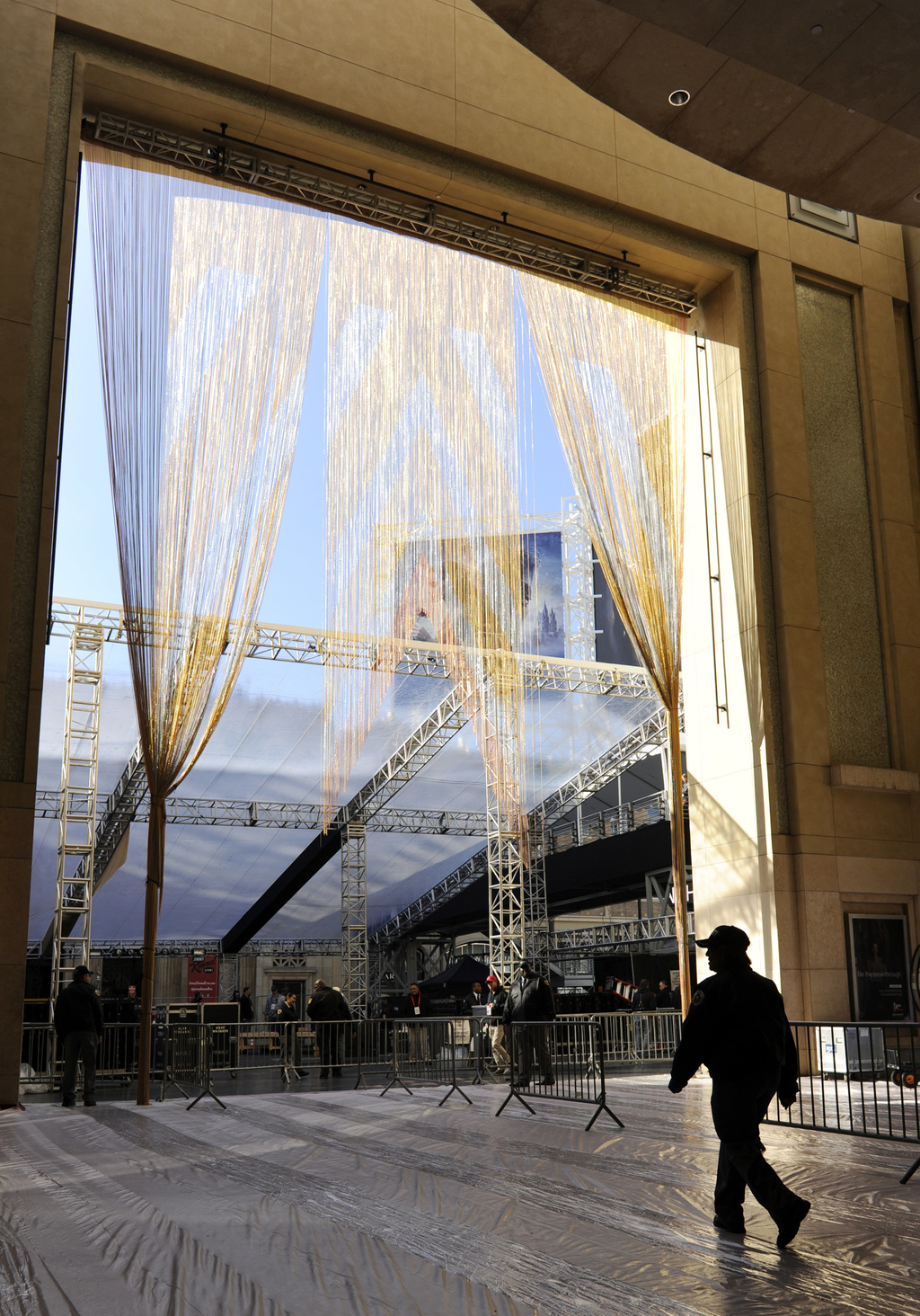 A gold curtain hangs down from the entrance to the Dolby Theatre in preparation for Sunday's 89th Academy Awards, on Wednesday, Feb. 22...
