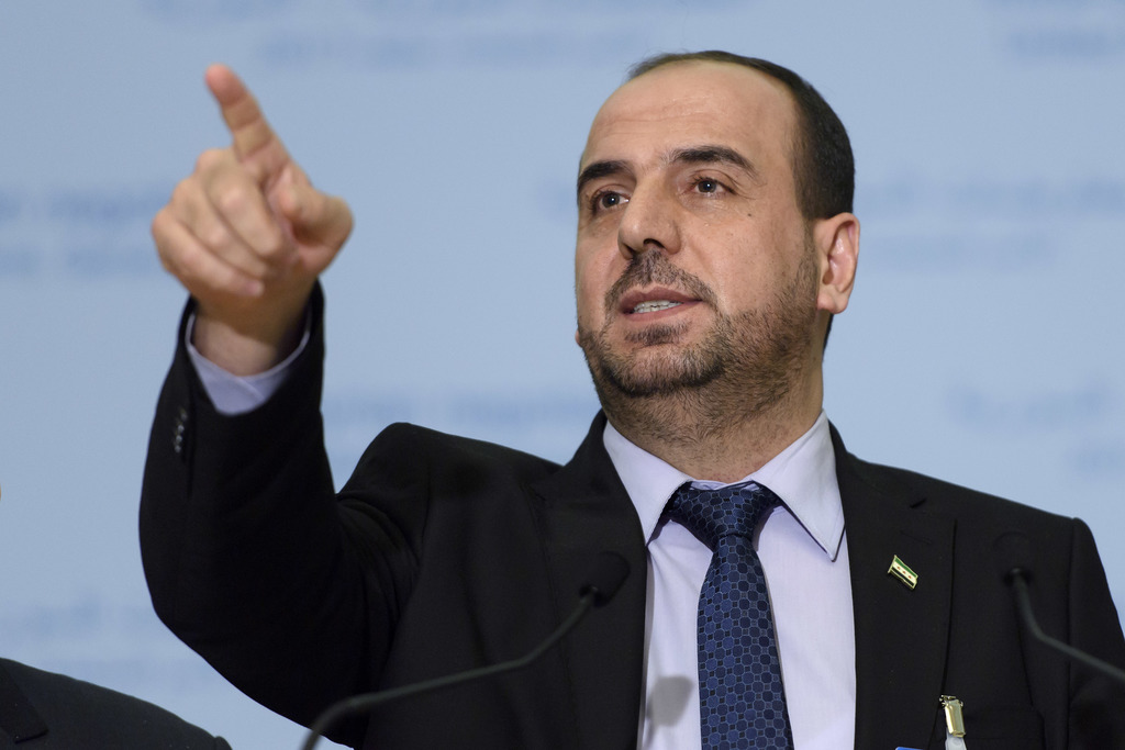 Syria's main opposition High Negotiations Committee, HNC, leader Nasr al-Hariri speaks during a news conference after talks between the...