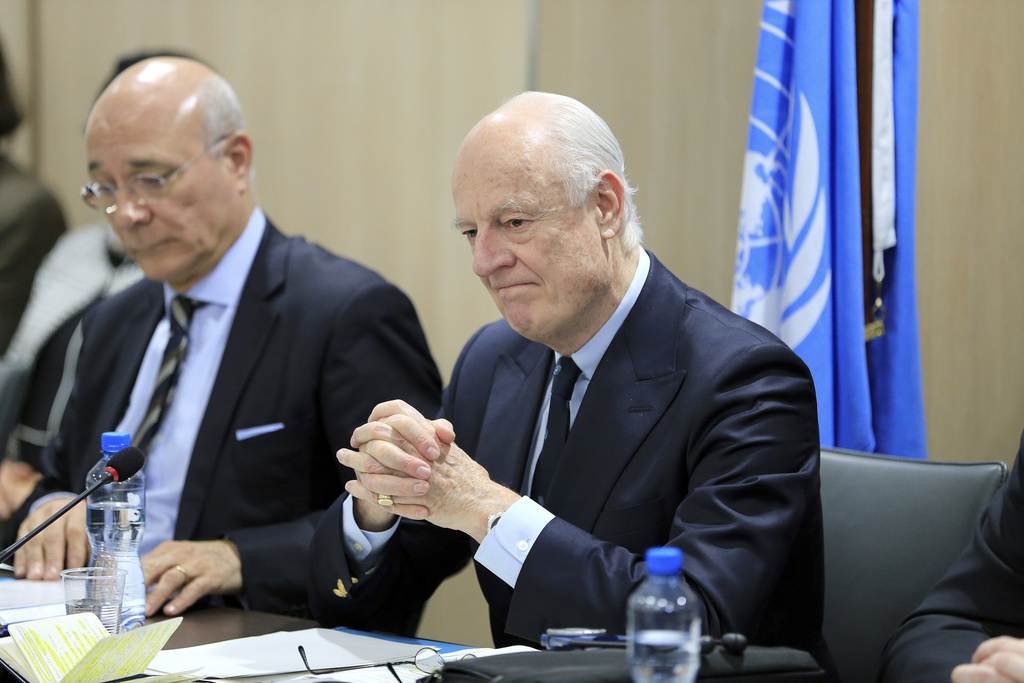 UN Special Envoy for Syria Staffan de Mistura, right, attends a meeting of Intra-Syria peace talks with Syrian government delegation at...