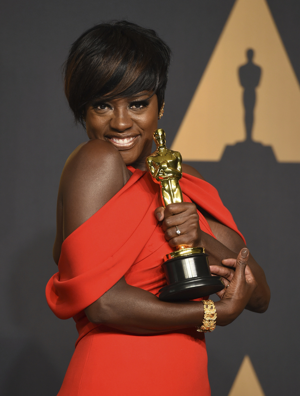 FILE - In this Feb. 26, 2017 file photo, Viola Davis poses in the press room at the Oscars at the Dolby Theatre in Los Angeles. Davis w...