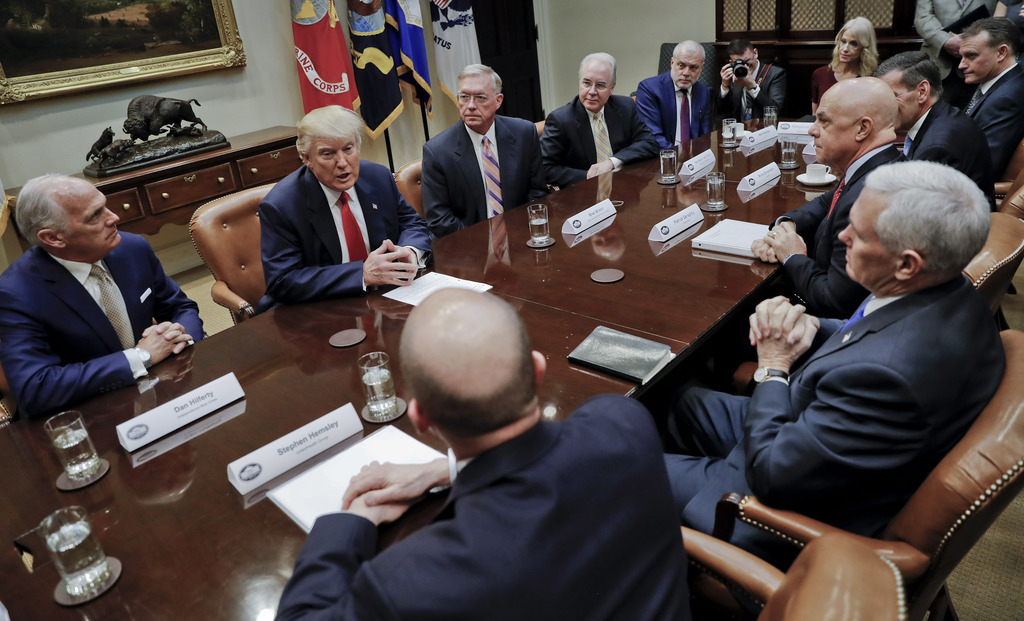 President Donald Trump, left, and Vice President Mike Pence, right, participate in a meeting with health insurance company executives i...