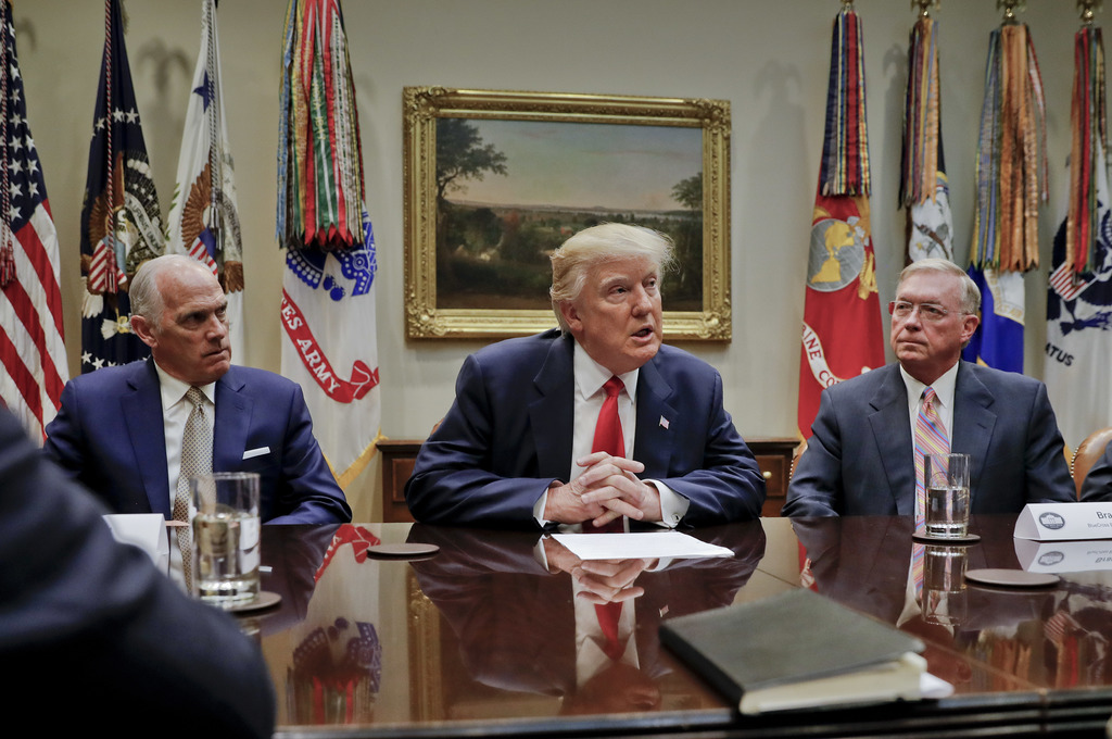 President Donald Trump, flanked by Independence Blue Cross CEO Daniel J. Hilferty, left, and Blue Cross and Blue Shield of North Caroli...