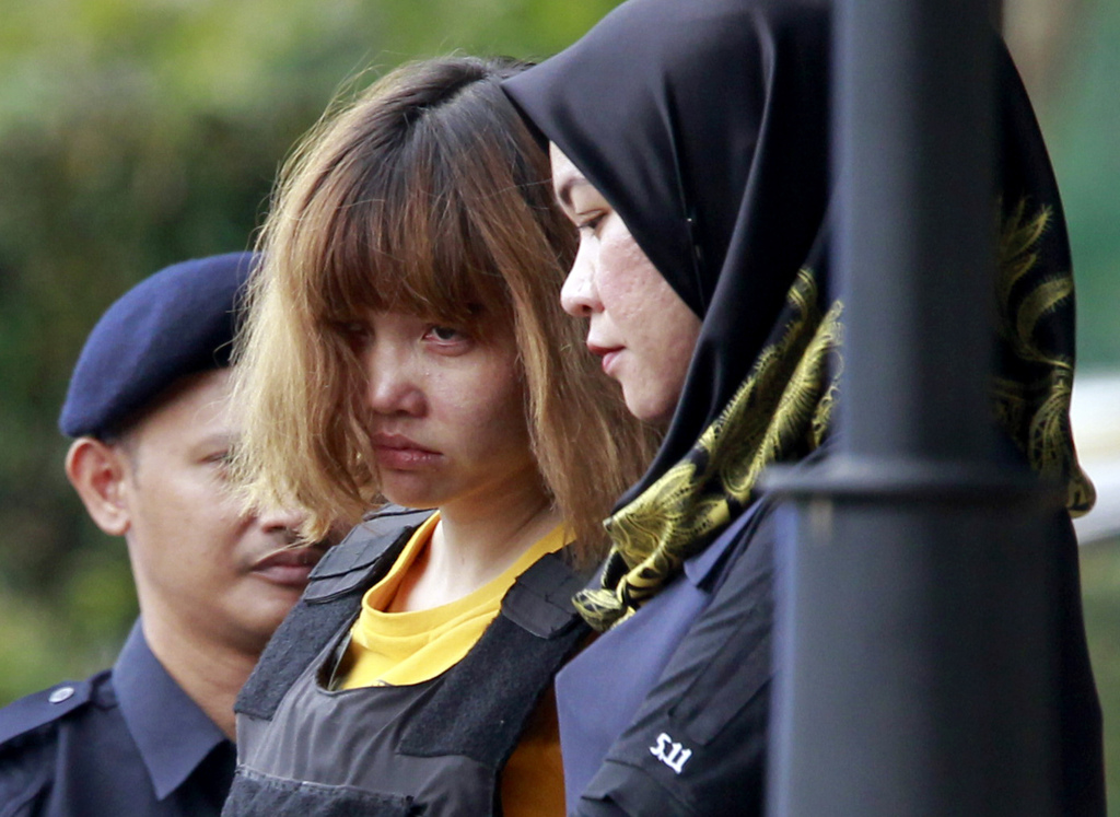 In this Wednesday, March 1, 2017, photo, Vietnamese suspect Doan Thi Huong, center, in the ongoing assassination investigation, is esco...