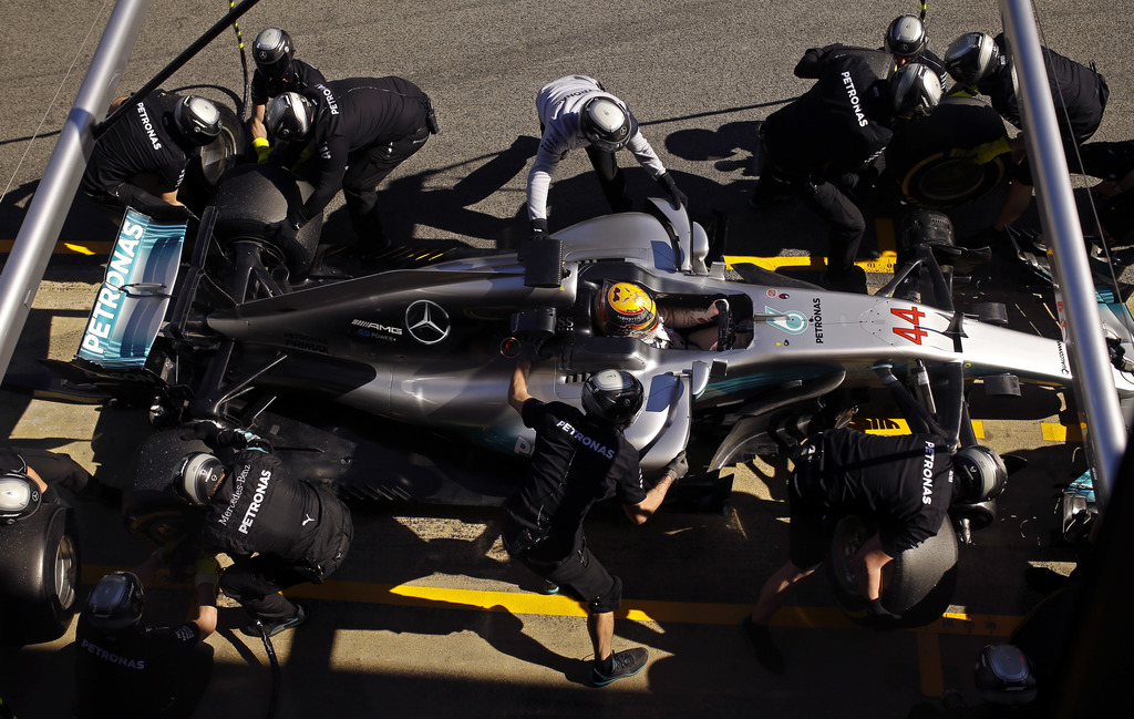 Mercedes driver Lewis Hamilton of Britain has his tyros changed during a Formula One pre-season testing session at the Catalunya racetr...